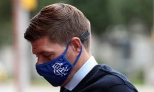 Rangers manager Steven Gerrard, wearing a face mask, arrives.