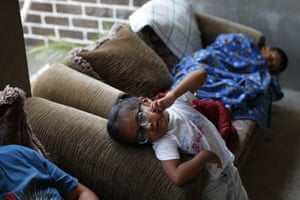 Displaced children rest inside an unfinished home in Chichihualco