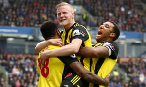 Will Hughes celebrates with teammates after scoring Watford's third goal in their 3-1 Premier League victory at Burnley.