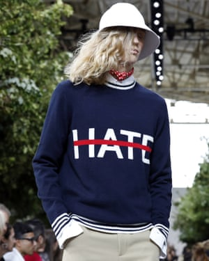 In one nautically-themed ensemble, a jumper was emblazoned with the word Hate crossed out.
