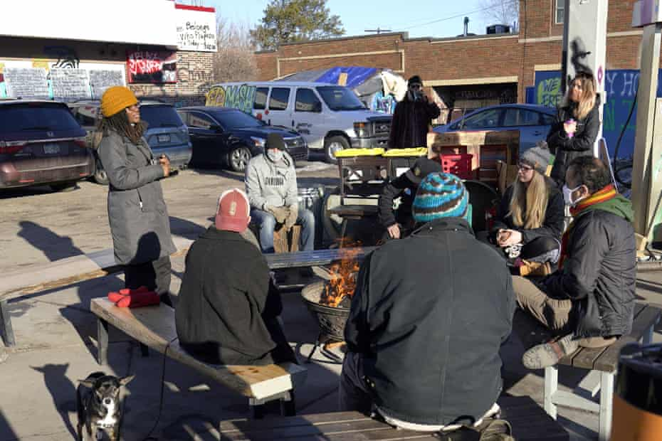 Marcia Howard, left, a group organizer, addresses activists and neighbors at George Floyd Square on 4 March.