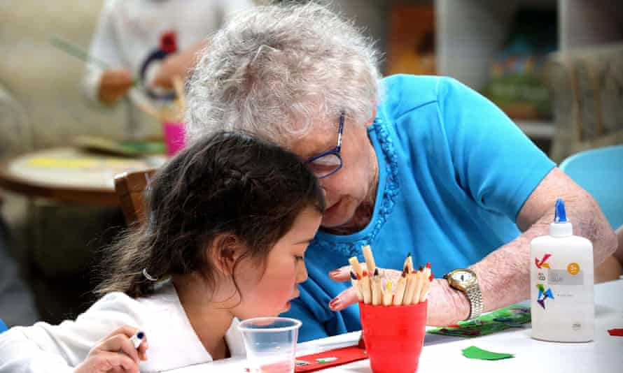 A retiree and preschooler in Old People's Home for 4 Year Olds