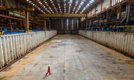 Lone figure in shipyard dry dock