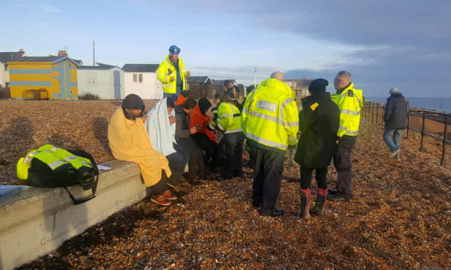 Suspected Channel crossers on a beach in Kent