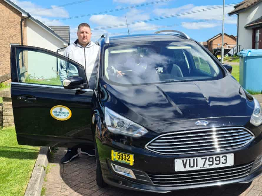 Barry Sloan next to his taxi outside his home in Glasgow.