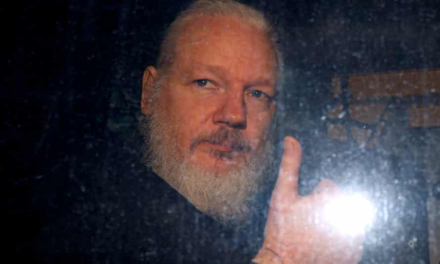 Julian Assange leaves a police station in London in April 2019