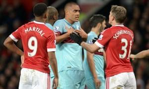 West Ham United's defender Winston Reid takes exception to Bastian Schweinsteiger's challenge.