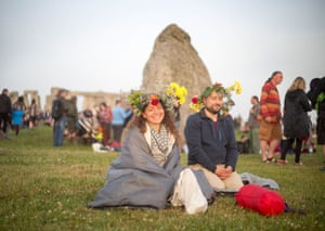 Sunrise was at 4.52am and was celebrated with dancing, music and ritualistic events around the stones – and flowery headdresses
