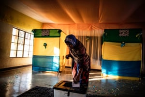 A woman in Kigali, Rwanda, casts her vote in the country's presidential election