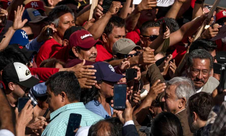 Mexico's President López Obrador greets supporters at a rally in Tijuana he said was a 'celebration' of the deal with the US that avoided tariffs on Mexican exports.