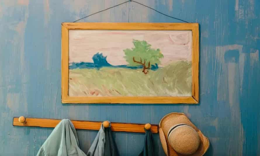 A picture of a tree in a field hangs above a coat rack in the Art Institute of Chicago's 3D replica of Van Gogh's Bedroom in Arles