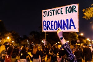 A protester carries a sign in honor of Breonna Taylor in Chicago, Illinois.