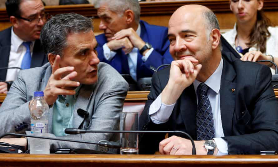 The Greek finance minister Euclid Tsakalotos, left, in Athens this July with Pierre Moscovici, European commissioner for economic affairs.