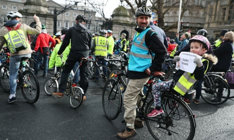 Jef Bucas and his daughter Lena protest outside Leinster House, Dublin, in 2017, calling for more of the transport budget to be allocated to cycling infrastructure.