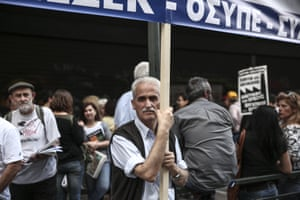 A man holds a banner during an anti-austerity rally outside the Ministry of Employment in Athens, Greece, on Thursday, May 28, 2015. Greece says it aims to clinch a deal with its creditors by Sunday, a development that would allow it to receive the desperately needed final installment of its international bailout plan and prevent a default. (AP Photo/Yorgos Karahalis)