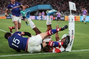 Japan's Kotaro Matsushima touches down for a try under pressure from Vasily Artemyev of Russia. His effort was disallowed during the opening game between Japan and Russia.