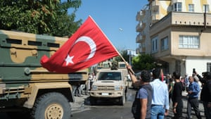 Akcakale, Turkey People greet Turkish soldiers in armoured vehicles as they head to northern Syria for a military operation in Kurdish areas, near the Syrian border. Turkey has launched an offensive targeting Kurdish forces in north-eastern Syria, days after the US withdrew troops from the region