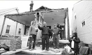 Gregory L Johnson and other workers on the house in Detroit.