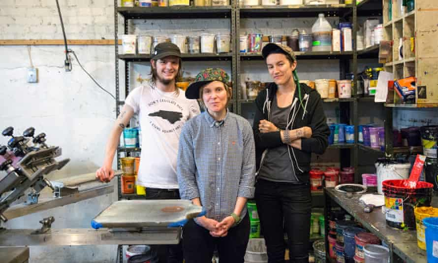 Zach Allbritton, SB and Bernard Stephens stand in the workspace of Lightning Bolt Ink in Asheville, North Carolina, on Thursday.