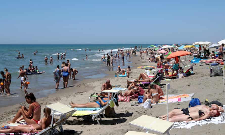 Beachgoers enjoy hot weather at the Lido di Castel Porziano in Rome