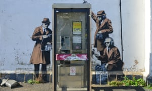 Banksy's mural depicting agents monitoring a phone box near GCHQ in Cheltenham.