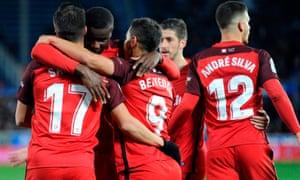 Sevilla's players celebrate after Wissam Ben Yedder's equaliser