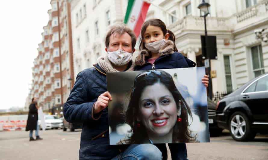 Richard Ratcliffe, the husband of Nazanin Zaghari-Ratcliffe, and their daughter, Gabriella protest outside the Iranian embassy in London.