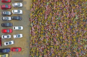 Tens of thousands of abandoned shared bikes piled up at a carpark in Nanjing city