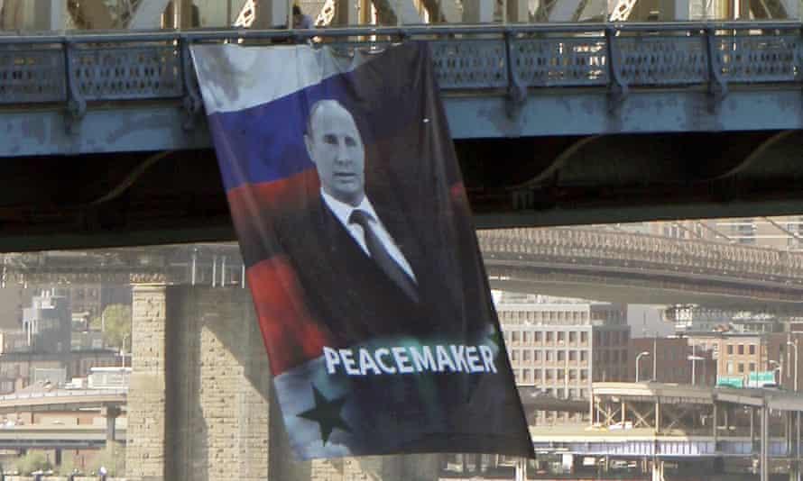 A banner portrait of Vladimir Putin hangs from Manhattan Bridge.
