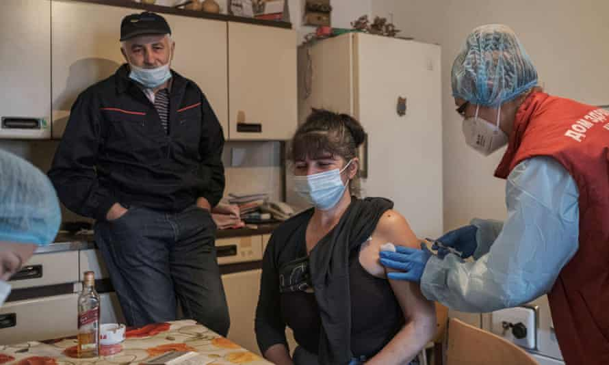 A woman receives a dose of the Chinese Sinopharm Covid-19 vaccine in the village of Leskovik near the city of Nis, Serbia.