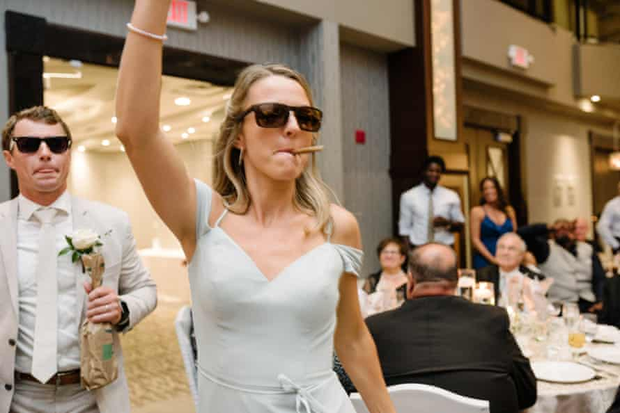 Amanda's maid of honor at the reception with a joint in her mouth.
