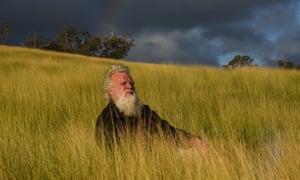 Bruce Pascoe sits among Australian native plant Mandadyan Nalluk (dancing grass) at his property in East Gippsland, Victoria