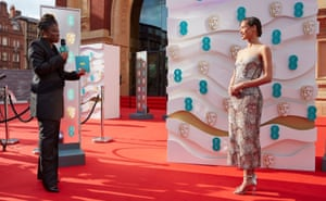 Clara Amfo interviews Gugu Mbatha-Raw on a socially distanced and sparsely attended red carpet before the recording.