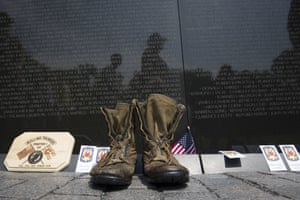 A pair of military boots are left at the Vietnam Veterans Memorial during the 30th anniversary of the Rolling Thunder 'Ride for Freedom' in Washington DC
