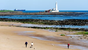 The beach at Whitley Bay with St Mary s Island beyond