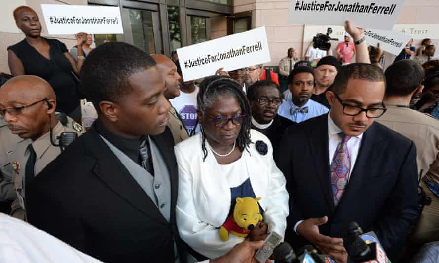 Jonathan Ferrell's brother Willie Ferrell, left, and his mother, Georgia Ferrell, answers reporters questions alongside family attorney Chris Chestnut, right, after a mistrial was declared yesterday.