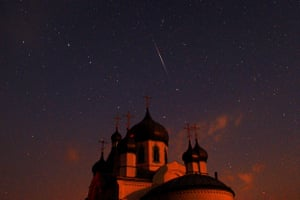 Perseids meteors cross the night sky over an Orthodox church in Belarus