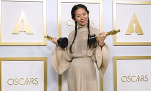 Chloé Zhao holds her two Oscars, for best director and best picture, for Nomadland. She's the first woman of color to win best director and only the second woman, after Kathryn Bigelow in 2010.