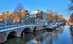 Amsterdam boat canal, at sunrise, in winter.