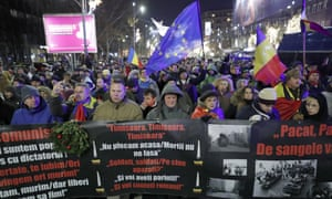 Romanians commemorate the 29th anniversary of the 1989 revolution while protesting against their government on 22 December.