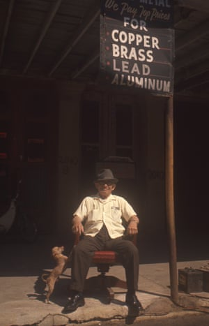 Man with dog and sign, c 1970