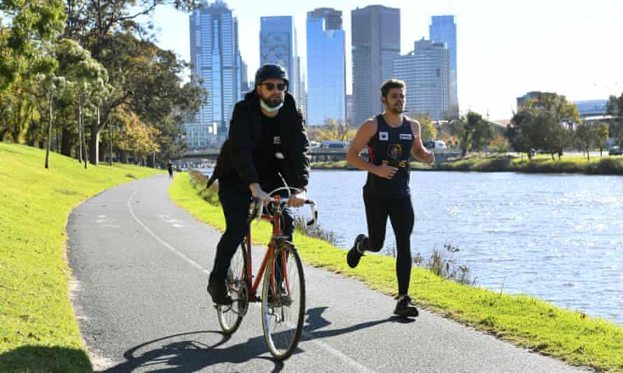 People exercise during Melbourne's lockdown in June.