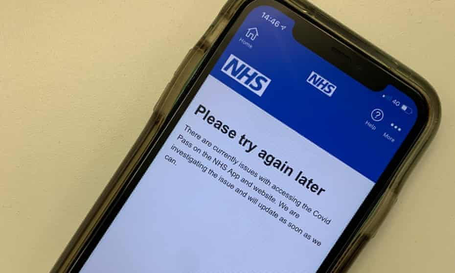 A smartphone showing the NHS Covid app and the message 'Pleas try again later'