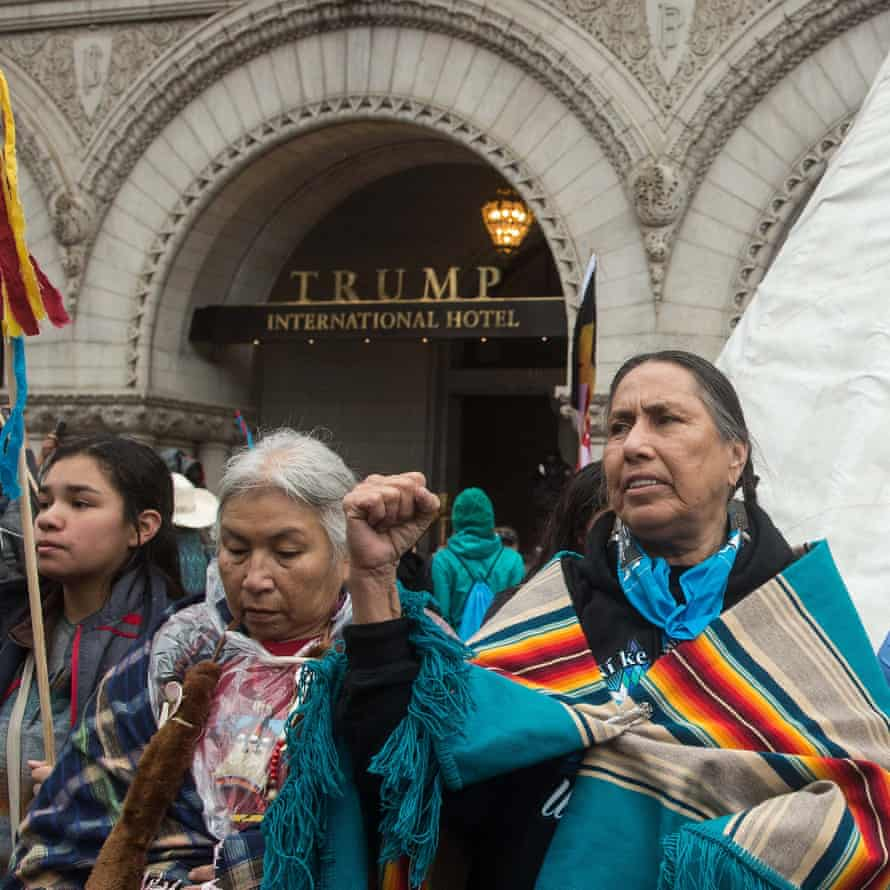People rally in front of Trump International Hotel during the Native Nations Rise protest in March.