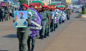 Soldiers in Bamenda carry the coffins of soldiers killed in violence that erupted in the Northwest and Southwest Regions of Cameroon, where most of the country's English-speaking minority live.
