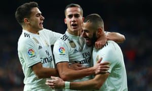 Real Madrid's Lucas Vázquez (centre) is congratulated by Karim Benzema (right) and Sergio Reguilón after sealing his side's victory over Valencia.