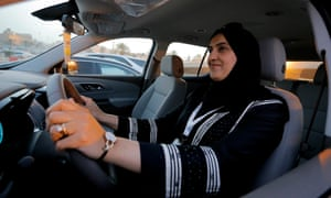 A woman tests a car in Riyadh, Saudi Arabia. Women will be allowed to drive in the kingdom from 24 June.