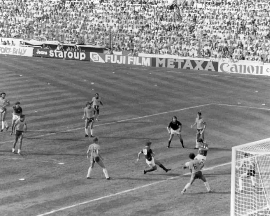 Italy's Paolo Rossi sweeps the ball home from the edge of the six-yard box to score the winning goal, complete his hat-trick and take his team to the semi-finals.