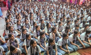 Girls listen to police officers talk about reporting sexual abuse, at a public school in Delhi.
