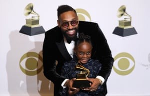 PJ Morton and Peyton Morton pose in the press room with the Grammy for Best R&B Song .
